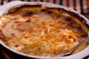 Romige aardappelgratin met ricotta en gruyere